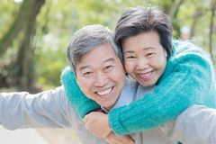 Old couple feel free. Old couple smile happily and feel free in the park Royalty Free Stock Images