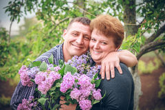Old couple with flower outdoor Stock Photo