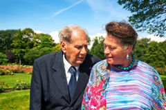 Old couple in garden Stock Photography