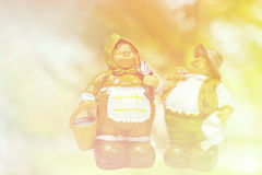 Old couple gardeners, ceramic dolls blurred background in vintag Stock Image