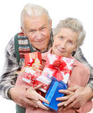 Old couple with gifts Royalty Free Stock Photos