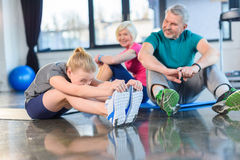 Old couple and girl stretching in fitness class for kids and senior people Royalty Free Stock Photography