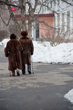 Old couple going to election of Russian President. MOSCOW, RUSSIA - MARCH 4: Old couple going to election of Russian President on March 4, 2012 in the local Royalty Free Stock Image