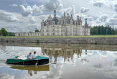 Old couple grandmother and grandfather travel together by boat in Loire, France Royalty Free Stock Photography
