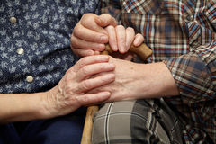 Old couple hands with cane Royalty Free Stock Images