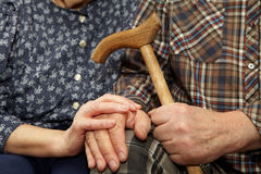 Old couple hands with cane Stock Image