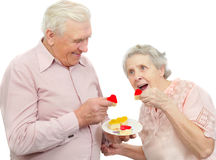 Old couple with heart-shaped cookies Stock Photos