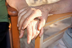 Old couple hold hand each other Stock Photo