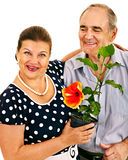 Old couple holding flower. Royalty Free Stock Photos