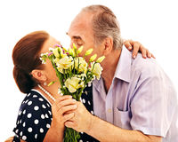Old couple holding flower. Royalty Free Stock Image