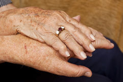Old couple holding hands with ring. On finger Royalty Free Stock Photos
