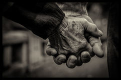 Old couple holding their hands. Detail of an old couple holding their hands royalty free stock image