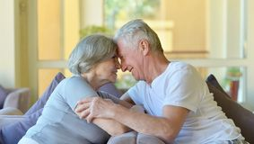 Old couple in hotel Stock Images