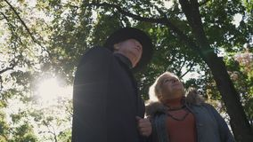 Old couple look up at the park