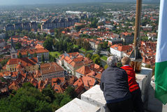 Old couple looking down on a city Ljubljana Royalty Free Stock Image