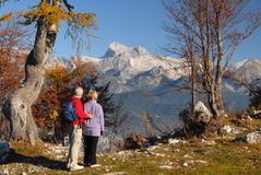 Old couple looking on mountains Royalty Free Stock Photography