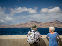 Old couple looking at sea Stock Photography