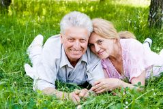 Old couple lying Royalty Free Stock Image