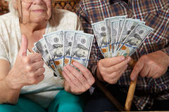 Old couple and money. Royalty Free Stock Images