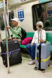 Old Couple at MRT Train With Luggage Royalty Free Stock Photo