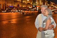 Old couple  on night street. Portrait of amusing old couple on night street Stock Photos