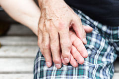 Old couple over seventy years holding hands. Hand with rheumatism Stock Photography