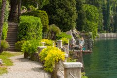 Old couple painting in Villa Monastero in Varenna, lake Como stock photo