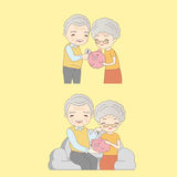Old couple with pink piggy Stock Images