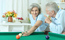 Old couple playing billiard Royalty Free Stock Images