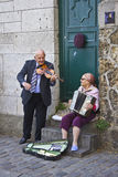 Happy Senior Couple Playing Music. Adorable Senior Couple Playing Music for Money In Paris stock images
