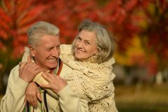 Old couple posing at autumn park Stock Photo