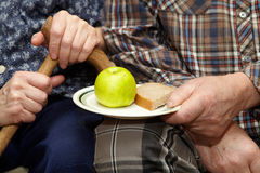 Old couple. Poverty. Apple and bread Royalty Free Stock Photography
