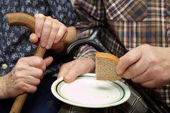 Old couple. Poverty and bread Stock Images