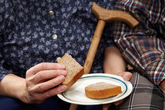 Old couple. Poverty and bread Royalty Free Stock Image