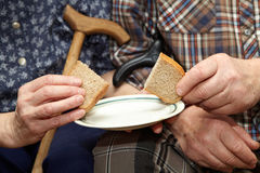 Old couple. Poverty and bread Stock Photos