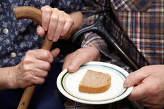 Old couple. Poverty and bread Royalty Free Stock Images
