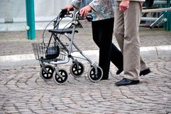 Old couple pushing rollator stock photography