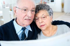 Old couple reading newspaper Royalty Free Stock Image