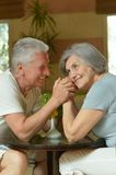 Old couple resting in hotel hall Stock Images