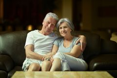 Old couple resting in hotel hall Royalty Free Stock Photo