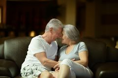 Old couple resting in hotel hall Royalty Free Stock Photos