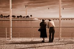 Old couple by the river stock images