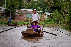 Old couple rowing on the river Mekong Royalty Free Stock Photography