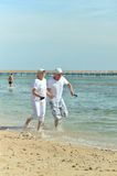 Old couple on sea beach Royalty Free Stock Image