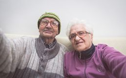 Old couple selfie. Grandmother and grandfather taking a selfie with camera stock images