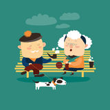 Old couple sitting on bench Stock Photo