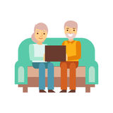 Old Couple Sitting On The Sofa With Lap Top, Person Being Online All The Time Obsessed With Gadget. Old Couple Sitting On The Sofa With Lap Top, Pe. Modern Royalty Free Stock Photo
