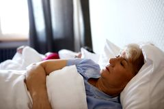 Old couple sleeping on bed Stock Images