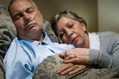 Old couple sleeping together man nasal cannula Royalty Free Stock Photos