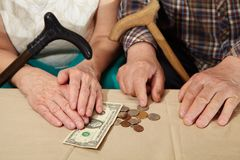 Poverty. Old couple and small coin. Royalty Free Stock Photography